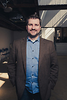 """Chronicle of Higher Education.<br /> Brian Sowards, founder and CEO of USEED considers himself a """"social entrepreneur"""".<br /> USEED is located in downtown Wilmington, DE in TheCoinLoft.com co-working space.<br /> <br /> © 2013 Joey Pulone"""