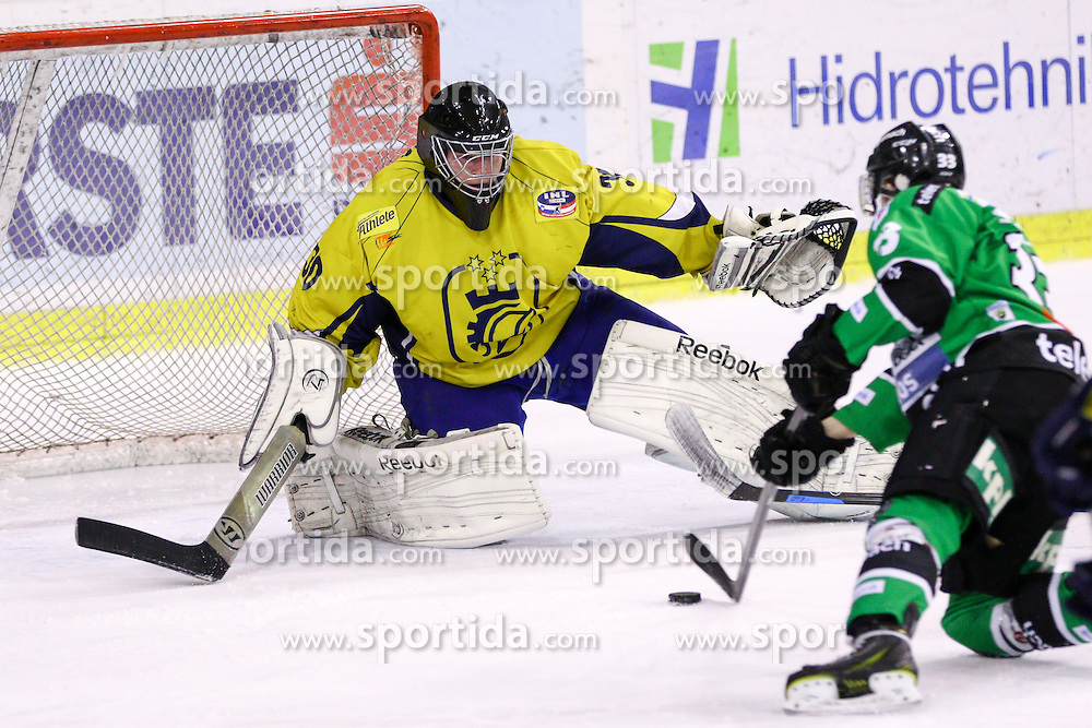 Jure Sotlar of Olimpija and Luka Kostomaj of Celje during ice hockey match between HDD Telemach Olimpija and HK Celje in first game of Semifinal at Slovenian National League, on March 27, 2015 at Hala Tivoli, Ljubljana. Photo by Matic Klansek Velej / Sportida.
