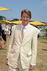 Film director TOM HOOPER at the Veuve Clicquot Gold Cup, Cowdray Park, Midhurst, West Sussex on 21st July 2013.