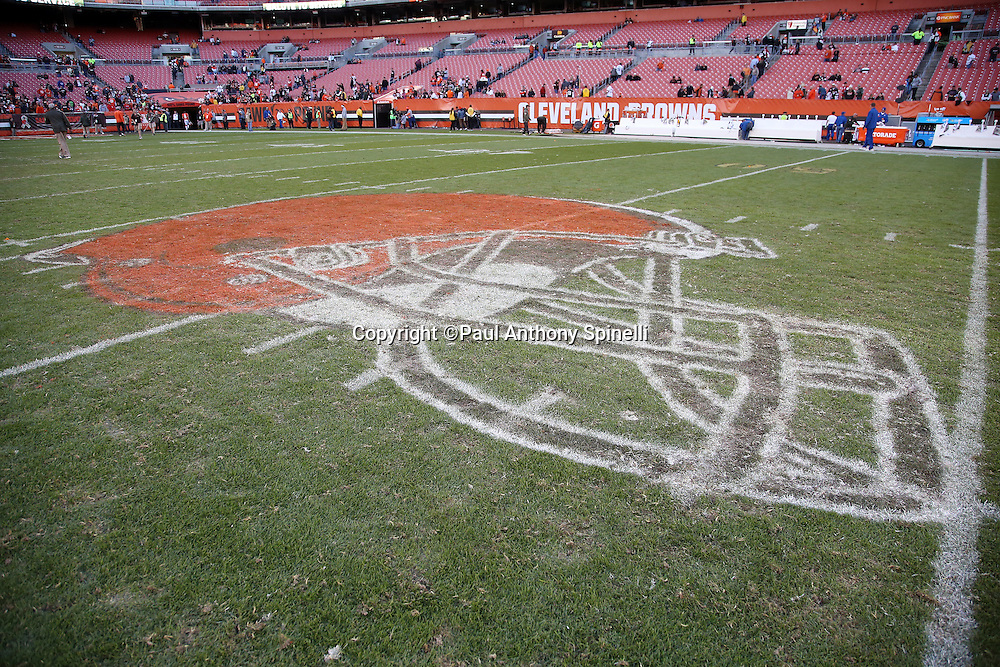 The Cleveland Browns helmet logo painted on the field grass is chewed up after the Cleveland Browns 2015 week 8 regular season NFL football game against the Arizona Cardinals on Sunday, Nov. 1, 2015 in Cleveland. The Cardinals won the game 34-20. (©Paul Anthony Spinelli)