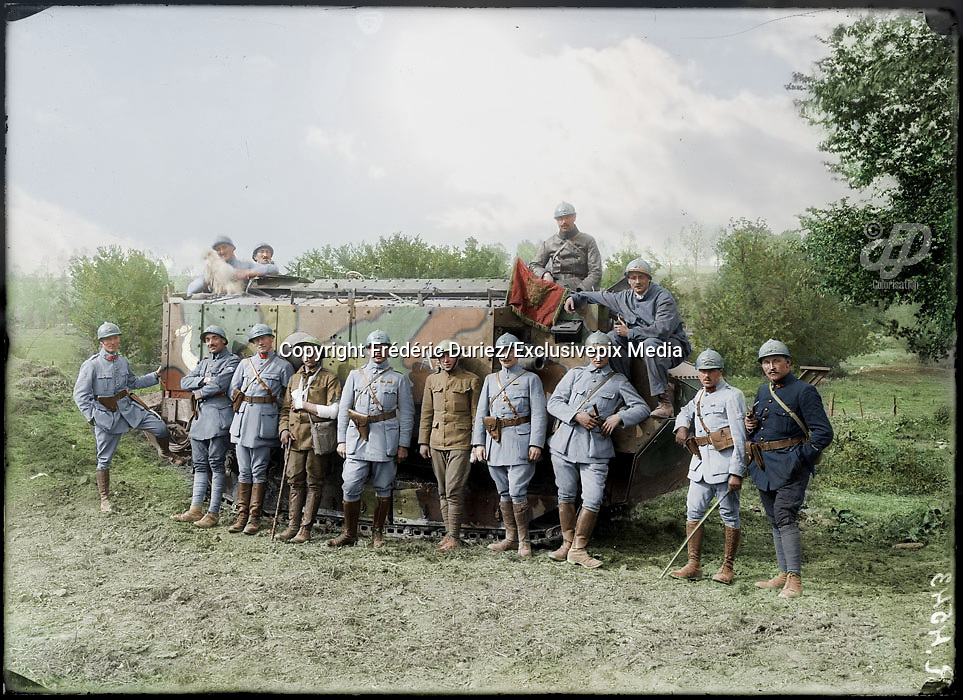 Colorized photographs soldiers from the World War One<br /> <br /> With his impressive colorized photographs of the World War One, Frédéric Duriez gives us a new look at the conflict that ravaged the world between 1914 and 1918, revealing the difficult daily life of the French soldiers. <br /> <br /> Photo Shows: 132/5000<br /> Some French and American officers who took part in the reconquest of cantigny in front of a Schneider French tank, May 1918.<br /> ©Frédéric Duriez/Exclusivepix Media