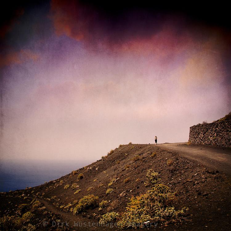 Hiker enjoying the sea view on the slopes of volcano Teneguia, La Palma, Canary Islands