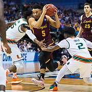 Loyola University Chicago junior Marques Townes cuts through two defenders during the first round game of the NCAA Tournament against the University of Miami at the American Airlines Center in Dallas, TX., on Thursday, March 15, 2018. (Photo: Lukas Keapproth)
