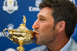 © Licensed to London News Pictures. 02/10/2012. LONDON, UK. European Ryder Cup Team captain José María Olazábal of Spain kisses the Ryder Cup trophy at a press conference at Heathrow Airport in London today (02/10/12) after winning the 39th Ryder Cup in Chicago, USA, on Sunday (30/09/12). Photo credit: Matt Cetti-Roberts/LNP