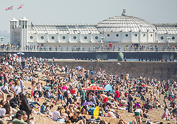 © Licensed to London News Pictures. 05/05/2018. Brighton, UK. Thousands of people take to the beach in Brighton and Hove on the May Bank Holliday Saturday as sunny and warm weather is hitting the seaside resort. Photo credit: Hugo Michiels/LNP