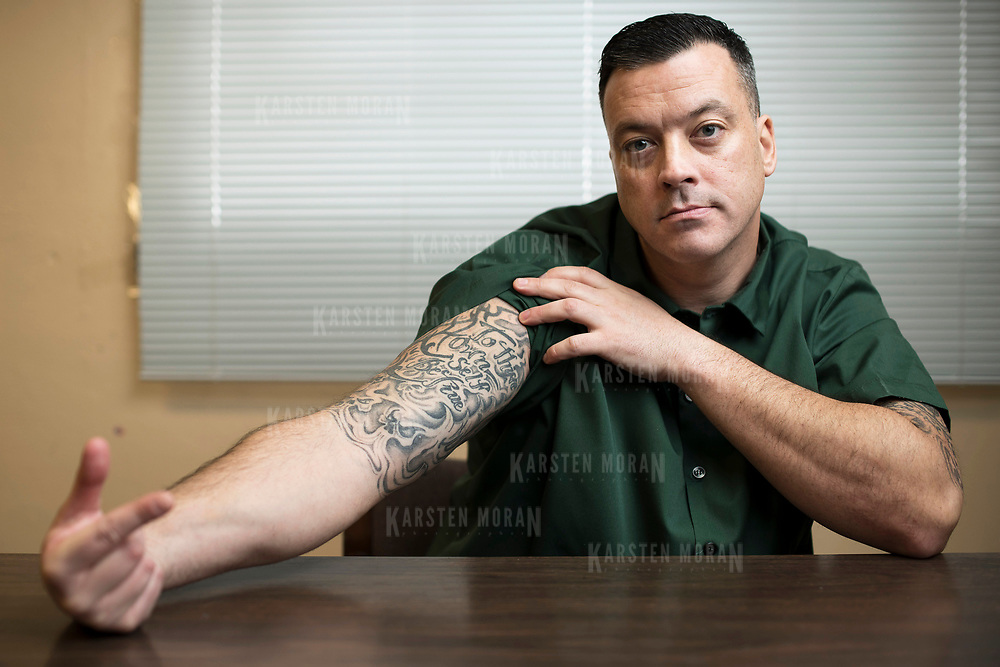 "January 19, 2018 - New York, NY :  John J. Lennon, a journalist and inmate at Sing Sing Correctional Facility in Ossining, New York, poses for a portrait in a room at the facility on Friday morning, January 19. His right arm bears the Shakespeare quote ""To thine own self be true.""  Lennon, who is serving a sentence of twenty-eight years to life, has been published in a number of major media outlets including The Atlantic, The New York Times, the Pacific Standard, and The Chronicle for Higher Education. CREDIT: Karsten Moran for The Marshall Project"