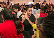 Staff and students participate in a pep rally to energize for STAAR testing at Garcia Elementary School, March 27, 2014.