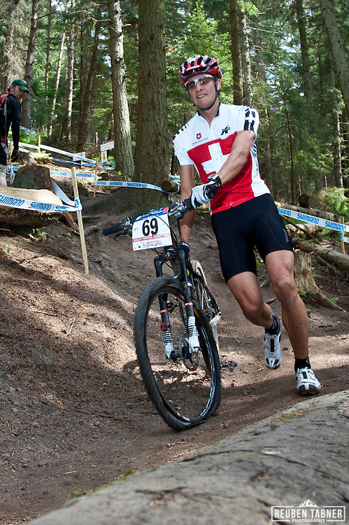 © Reuben Tabner. .Pickering, North Yorkshire, UK  20/05/11. Dumeni Vincenz (Switzerland) (DNF) runs drown the course with a front flat during the mens under 23 race. 2011 UCI Mountain Bike Cross-Country World Cup at Dalby Forest..Please see special instructions for usage rates. Photo credit should read: Reuben Tabner