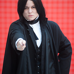 London, UK - 26 May 2013: Emily Burns dressed as Severus Snape of Harry Potter poses for a picture during the London Comic Con 2013 at Excel London. London Comic Con is the UK's largest event dedicated to pop culture attracting thousands of artists, celebrities and fans of comic books, animes and movie memorabilia.