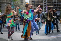 April 30, 2017 - New York, NY, United States - Before a scheduled march to promote love and the power of positive emotions, participants in the ''Love Parade'' rallied and danced on the North end of Union Square Park in New York. (Credit Image: © Albin Lohr-Jones/Pacific Press via ZUMA Wire)