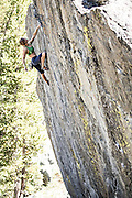 """Professional climber Lisa Rands bouldering on the """"high ball"""" problem """"Drunken Chicken"""" rated V6, at the """"Way Lake"""" boulders near Mammoth Lakes California."""