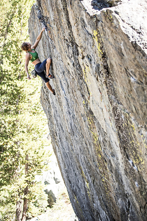 "Professional climber Lisa Rands bouldering on the ""high ball"" problem ""Drunken Chicken"" rated V6, at the ""Way Lake"" boulders near Mammoth Lakes California."