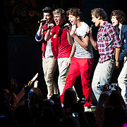 May 26, 2012 - New York, NY : Pop sensation 'One Direction,' comprised of, (holding microphones) from left, Zayn Malik, Niall Horan, Louis Tomlinson, Liam Payne, and Harry Styles perform to a sold-out crowd at the Beacon theater in Manhattan on  Saturday afternoon. The group is on the road for their first-ever headlining North American tour in support of their debut album UP ALL NIGHT. CREDIT: Karsten Moran for The New York Times