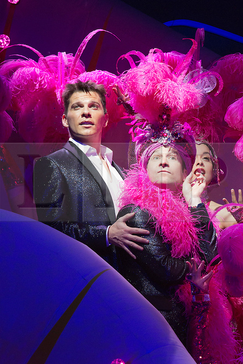 """© Licensed to London News Pictures. 21 March 2014. London, England. Pictured: Nigel Harman as Simon and Billy Carter as Gerrard Smalls. Photocall for the Simon Cowell X-Factor Musical """"I Can't Sing!"""" written by Harry Hill and Steve Brown at the London Palladium. Directed by Sean Foley with Nigel Harman as Simon, Victoria Elliott as Jordy and Ashley Knight as Louis. Photo credit: Bettina Strenske/LNP"""