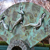 Tribute to Olympism and Hellenism in Atlanta, Georgia<br /> The ancient competition among athletes began in Olympia, Greece in 776 BC. The modern version originated in Athens in 1896. And Atlanta hosted the 1996 Summer Olympics. Also known as the XXVI Olympiad, it was considered to be the Centennial Olympic Games. The three runners emerging from this bronze, fan-shaped sculpture celebrates those three events. This creation of Peter Calaboyias was a gift from Olympia. The 17 by 24 foot sculpture is located at the Atlanta Olympic Park.