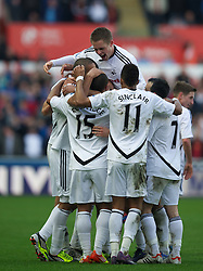 SWANSEA, WALES - Sunday, March 11, 2012: Swansea City's Luke Moore is mobbed by team-mates after scoring the only goal of the game against Manchester City during the Premiership match at the Liberty Stadium. (Pic by David Rawcliffe/Propaganda)