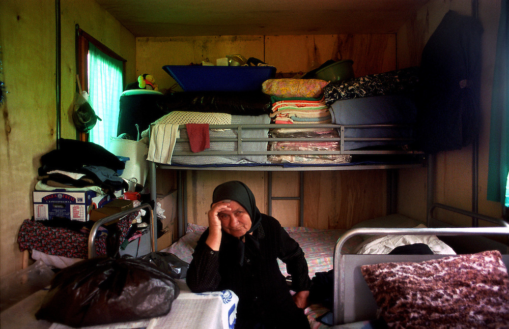 Osojane in Kosovo is the first village were serbs that fled after NATO's bombing campaign ended have been returned as a group by the UN. The village is surrounded by Spanish Kfor soldier on every side and the German government has pledged the money to rebuilt 55 homes. Stojka Repanovic is in the barrack she shares with her husband and adult son, they are waiting for a new home to be built for them. Their old homes being to destroyed to rebuilt. They have been waiting for 9 months. Osojane, Kosovo...Serbs living in enclaves in Kosovo.