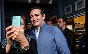 Republican presidential candidate, Sen. Ted Cruz, R-Texas, takes a picture with a supporter at a meet and greet at Theo's Pizza and Restaurant in Manchester, N.H. Thursday, Jan. 21, 2016.  CREDIT: Cheryl Senter for The New York Times Ted Cruz