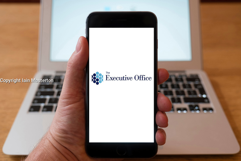 Using iPhone smartphone to display logo of Northern Ireland Executive Office