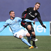 NEW YORK, NEW YORK - March 12:  Maxime Chanot #4 of New York City FC challenged by Patrick Mullins #16 of D.C. United during the NYCFC Vs D.C. United regular season MLS game at Yankee Stadium on March 12, 2017 in New York City. (Photo by Tim Clayton/Corbis via Getty Images)