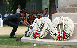 © Licensed to London News Pictures. 11/11/2012. Delhi, India. An officer of the Indian Army places a wreath at a memorial at a Remembrance Day ceremony held at the Delhi War Cemetery, India. Remembrance Day (also known as Poppy Day or Armistice Day) is a memorial day observed in Commonwealth countries since the end of World War I to remember the members of their armed forces who have died in the line of duty. This day, or alternative dates, are also recognized as special days for war remembrances in many non-Commonwealth countries. Remembrance Day is observed on 11 November to recall the end of hostilities of World War I on that date in 1918.   Photo credit : Richard Isaac/LNP
