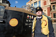 UNITED KINGDOM, London: 26 February 2018 <br /> A WWII re-enactor stands in front of a 23 foot Lancaster Bomber replica in front of The Royal Albert Hall this morning to mark the 75th anniversary since 'Operation Chastise' was given final approval. It also comes before a gala screening of The Dam Busters which will be shown in May to make the occasion.<br /> Photograph: Rick Findler