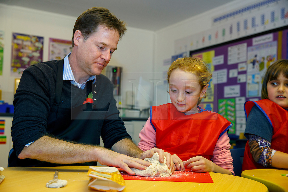 © Licensed to London News Pictures. 03/11/2014. LONDON, UK. The Deputy Prime Minister Nick Clegg participates in a bread making lesson at Weston Park Primary School in Crouch End, London on Monday 3 November 2014. Photo credit : Tolga Akmen/LNP