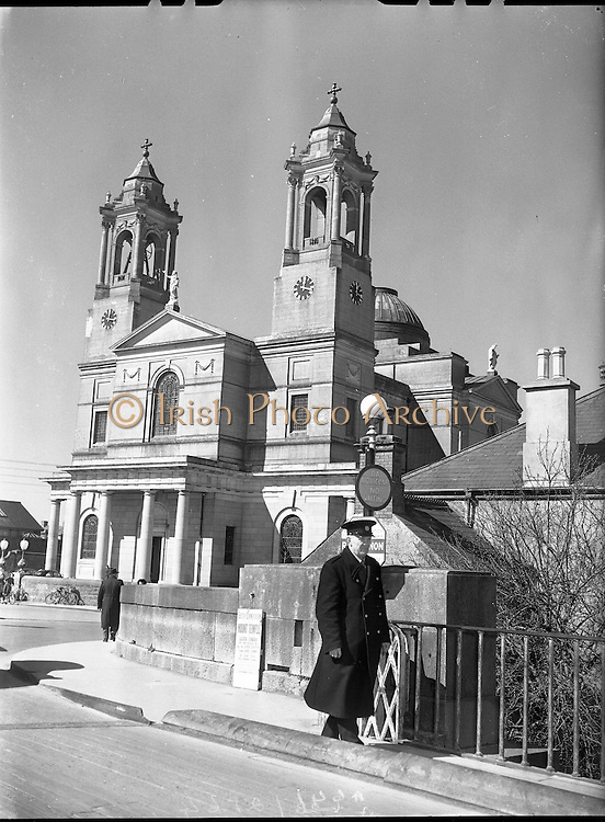 View of Garda on the beat by St Peter and Paul Church, Athlone,  Westmeath.<br />  02/04/1958