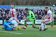 Forest Green Rovers Christian Doidge(9) through on goal but Cheltenham Town goalkeeper Scott Flinders(24) claims the ball during the EFL Sky Bet League 2 match between Forest Green Rovers and Cheltenham Town at the New Lawn, Forest Green, United Kingdom on 25 November 2017. Photo by Shane Healey.