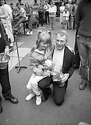 "Fr Niall O'Brien Returns from Captivity.1984..14.07.1984..07.14.1984..On 6 May 1983,Fr Niall O'Brien was arrested along with two other priests, Fr. Brian Gore, an Australian, Fr. Vicente Dangan, a Filipino and six lay workers - the so-called ""Negros Nine"", for the murders of Mayor Pablo Sola of Kabankalan and four companions. The priests where held under house arrest for eight months but ""escaped"" to prison in Bacolod City, the provincial capital, where they felt they would be safer.The case received widespread publicity in Ireland and Australia, the home of one of the co-accused priests, Fr. Brian Gore. When Ronald Reagan visited Ireland in 1984, he was asked on Irish TV how he could help the missionary priest's situation. A phone call the next day from the Reagan administration to Ferdinand Marcos resulted in Marcos offering a pardon to Fr. O'Brien and his co-accused..(Ref Wikipedia)...Fr O'Brien is pictured with a young girl at the Mansion House in Dublin."