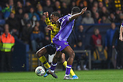 Shrewsbury Town defender Ro-Shaun Williams (5) fouls Oxford United midfielder Tarique Fosu-Henry  (11) during the EFL Sky Bet League 1 match between Oxford United and Shrewsbury Town at the Kassam Stadium, Oxford, England on 7 December 2019.