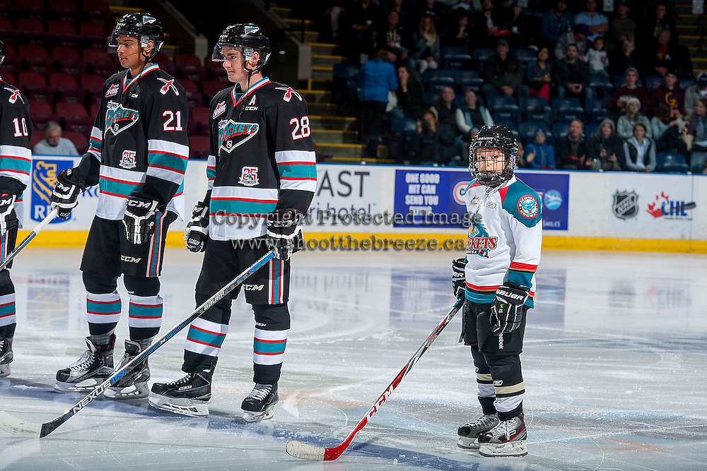 KELOWNA, CANADA - OCTOBER 23: Devante Stephens #21 and Joe Gatenby #28 of Kelowna Rockets line up against the Prince George Cougars with the Pepsi Save On Foods Player of the Game on October 23, 2015 at Prospera Place in Kelowna, British Columbia, Canada.  (Photo by Marissa Baecker/Shoot the Breeze)  *** Local Caption *** Joe Gatenby; Devante Stephens; Pepsi Save On Foods player of the game;