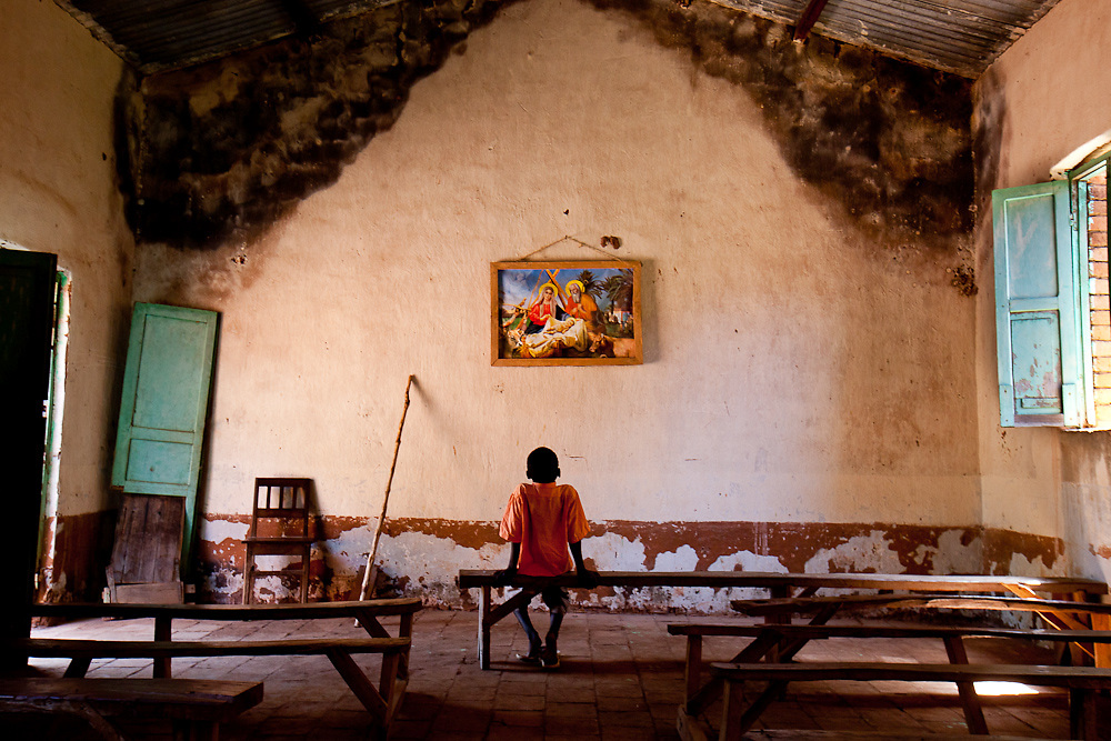 A boy stares at a painting of baby Jesus in a Catholic church in Tambura near the border of the Central African Republic days after the LRA attacked a nearby village, and killed the region's education minister. A new generaration in growing up in peace for the first time in decades, but these gains are fragile and constantly threatened by an uncertain future.