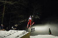 A skier launches off the jump during Plymouth High Schools ski jump meet on Friday evening.  (Karen Bobotas/for the Laconia Daily Sun)