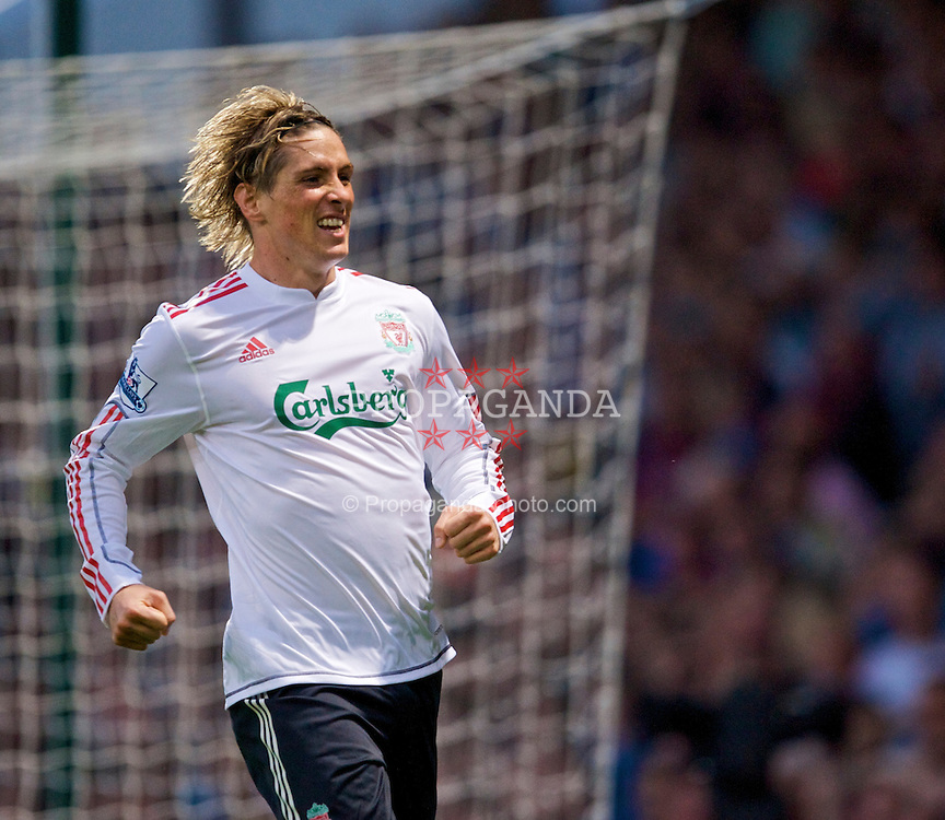 LONDON, ENGLAND - Saturday, September 19, 2009: Liverpool's Fernando Torres celebrates scoring the third goal, his second of the game, against West Ham United to seal a 3-2 victory during the Premiership match at Upton Park. (Pic by David Rawcliffe/Propaganda)