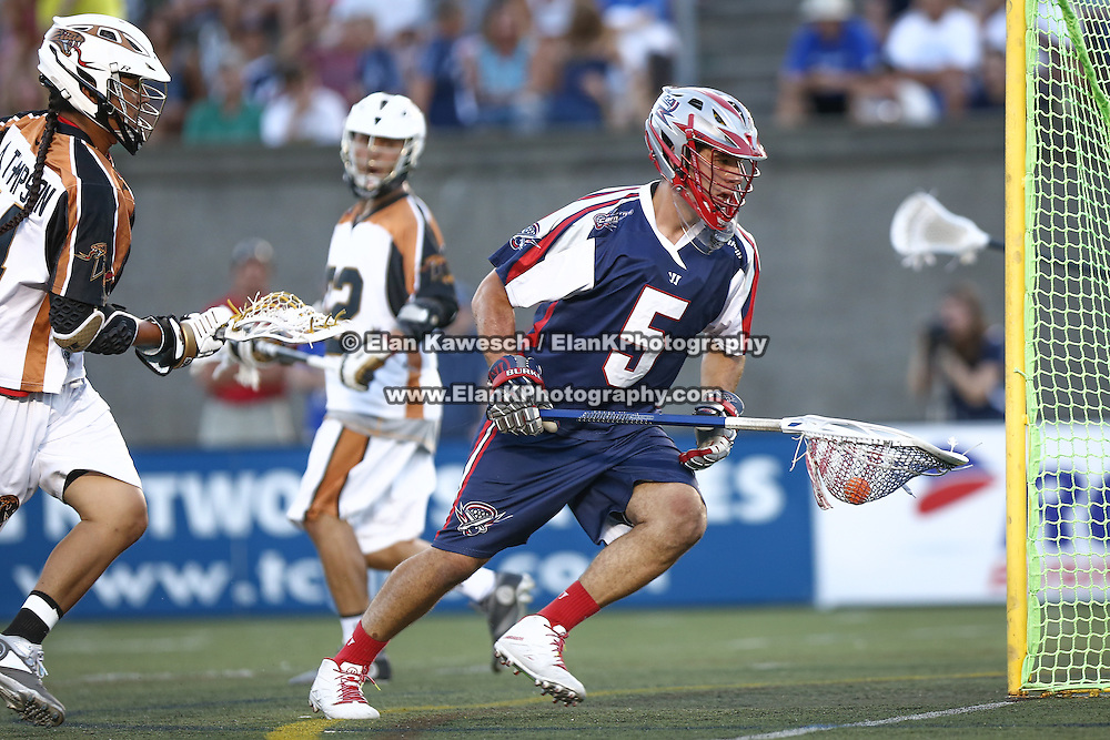 Jordan Burke #5 of the Boston Cannons controls the ball during the game at Harvard Stadium on August 9, 2014 in Boston, Massachusetts. (Photo by Elan Kawesch)