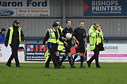 Referee Dale Wootton leaves the pitch with a stewards escort during the National League South match between Havant & Waterlooville FC and St Albans FC at Westleigh Park, Havant , United Kingdom on 22 February 2020.