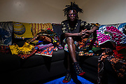 "Kibera based fashion designer David Avido ""LooksLikeAvido"", in his house surrounded by fabrics, in the township of Kibera in Nairobi Kenya on Tuesday 17th of September."