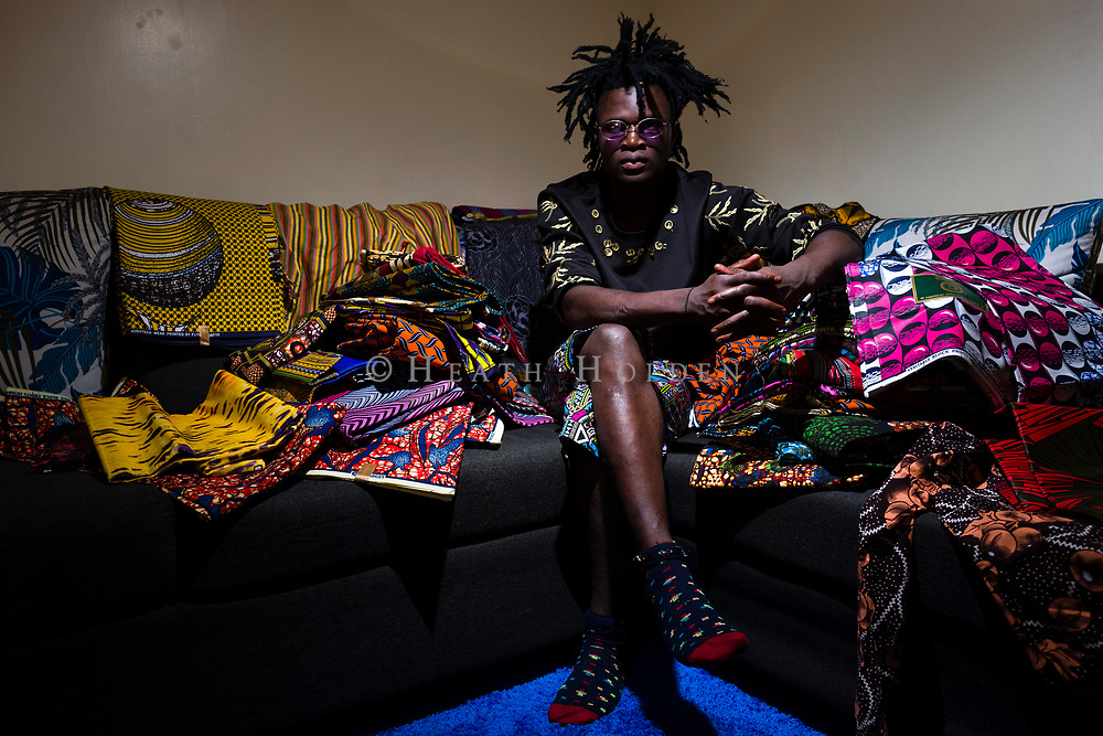 "Kibera based fashion designer David Avido ""LooksLikeAvido"", in his house surrounded by fabrics, in the township of Kibera in Nairobi Kenya on Tuesday 17th of September."