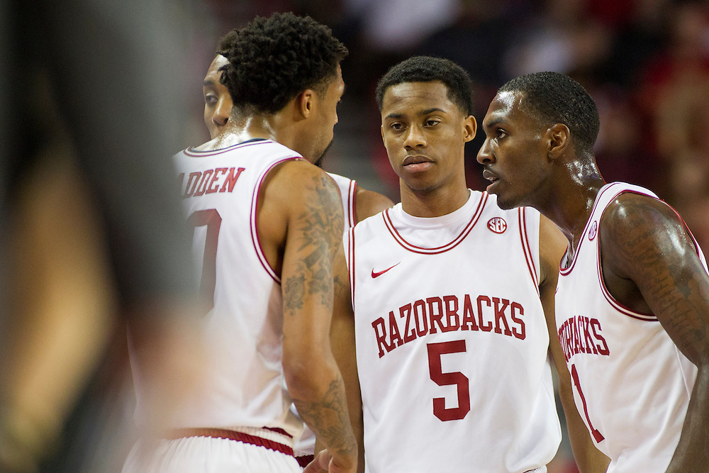 FAYETTEVILLE, AR - JANUARY 12:  Rashad Madden #00, Anthlon Bell #5 and Mardracus Wade #1 of the Arkansas Razorbacks huddle together during a game against the Vanderbilt Commodores at Bud Walton Arena on January12, 2013 in Fayetteville, Arkansas.  The Razorbacks defeated the Commodores 56-33.  (Photo by Wesley Hitt/Getty Images) *** Local Caption *** Rashad Madden; Anthlon Bell; Mardracus Wade