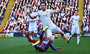 Daley Blind taks a tumble from Yohan Cabaye's challenge during the Barclays Premier League match between Crystal Palace and Manchester United at Selhurst Park, London, England on 31 October 2015. Photo by Michael Hulf.