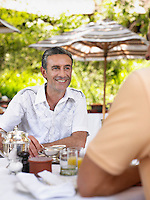 Two men having conversation at table selective focus