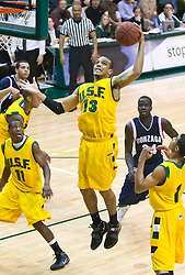 January 30, 2010; San Francisco, CA, USA;  San Francisco Dons guard Rashad Green (13) grabs a rebound against the Gonzaga Bulldogs during the first half at the War Memorial Gym.  San Francisco defeated Gonzaga 81-77 in overtime.
