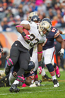 06 October 2013: Running back (23) Pierre Thomas of the New Orleans Saints runs the ball against the Chicago Bears during the second half of the Saints 26-18 victory over the Bears in an NFL Game at Soldier Field in Chicago, IL.