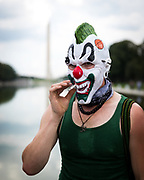 Joseph Thomson, of New Hampshire, smokes during the Juggalo March on Washington near the Lincoln Memorial on Saturday, Sept. 16, 2017 in Washington. Supporters of the hip-hop musicians Insane Clown Posse, known as Juggalos, rallied to protest the FBI's classification of the Juggalo community as a gang.