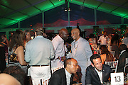 Water Mill, New York: Music Mogul Russell Simmons attend the RUSH Philanthropic Arts Foundation 15th Annual Art For Life Benefit Gala held in the Hamptons at the Farmview Farms on July 26, 2014  in Water Mill, New York. (Terrence Jennings)