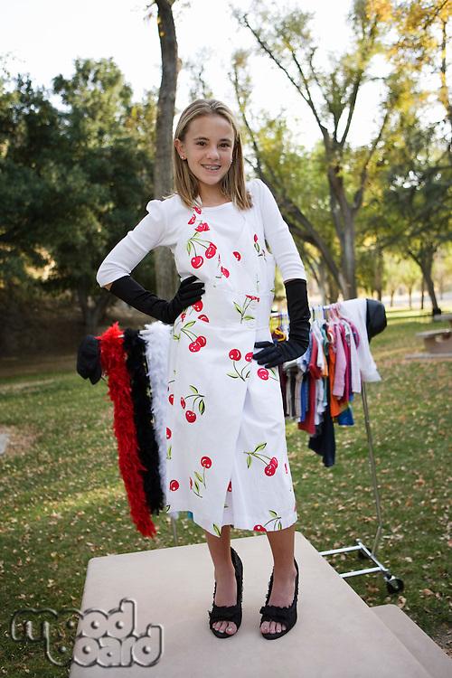 Girl (10-12) posing on catwalk in park