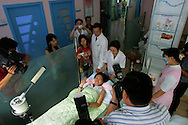 Hao Lulu, famous in China for her drive to transform herself through plastic surgery greets the media as she prepares to undergo her 22nd operation in Beijing, China Aug. 24, 2005. An Estimated one million Chinese people per year flocking to plastic surgery as a way to boost their confidence as expendable incomes grow. Fueling the trend is a desire to compete in a rapidly changing society where image and first impressions count and social stigmas on buying perfection are few. A few decades ago, a Chinese woman could have been denounced and maybe even beaten for wearing lipstick, much less undergoing surgery to improve their looks. In the 1960s and 1970s, the closest thing to a Chinese beauty ideal was Liu Hulan, a robust 15-year-old country girl with a practical bob and not a trace of makeup who was decapitated by the Nationalists when she refused to name her fellow Communists in 1947.