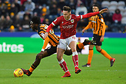 Hull City defender Ola Aina (34) and Bristol City midfielder Josh Brownhill (8) during the EFL Sky Bet Championship match between Hull City and Bristol City at the KCOM Stadium, Kingston upon Hull, England on 25 November 2017. Photo by Ian Lyall.