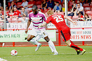Barnet FC Striker John Akinde (9) takes on Crawley Town Defender Josh Yorwerth (25) during the Sky Bet League 2 match between Crawley Town and Barnet at the Checkatrade.com Stadium, Crawley, England on 7 May 2016. Photo by Andy Walter.
